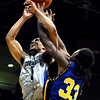 Colorado's Marcus Relphorde (left) fights Coppin State's Same Coleman (right) for a rebound during their basketball game at the University of Colorado in Boulder, Colorado November 16, 2009. CAMERA/Mark Leffingwell