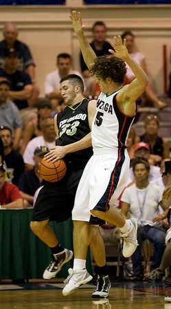 Colorado forward Austin Dufault (33) grabs a rebound from Gonzaga guard Matt Bouldin (15) in the first half during their game in the Maui Invitational NCAA college basketball tournament at the Lahaina Civic Center in Lahaina, Hawaii on Monday Nov. 23, 2009.  (AP Photo/Eugene Tanner)