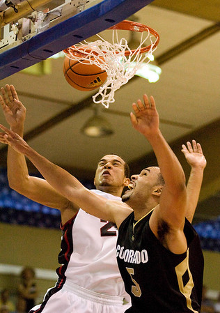 Colorado forward Marcus Relphorde (5) has his shot blocked by Gonzaga forward Elias Harris (20) in the second half in their game at the Maui Invitational NCAA college basketball tournament on Monday, Nov. 23, 2009. Gonzaga defeated Colorado 76-72.  (AP Photo/Eugene Tanner)