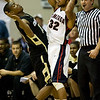 Colorado guard Cory Higgins (11) leans back to avoid Gonzaga guard Steven Gray (32) in the first half during their game in the Maui Invitational NCAA college basketball tournament at the Lahaina Civic Center in Lahaina, Hawaii on Monday Nov. 23, 2009.  (AP Photo/Eugene Tanner)