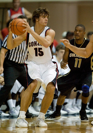 Colorado guard Cory Higgins (11) looks on as Gonzaga guard Matt Bouldin (15) looks for a teammate to pass to during the second half of an NCAA college basketball game in the Maui Invitational on Monday, Nov. 23, 2009, in Lahaina, Hawaii. Gonzaga defeated Colorado 76-72. (AP Photo/Eugene Tanner)