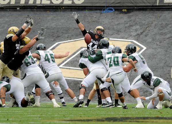 University of Colorado defensive end Nick Kasa, right, and other Buff defenders try to block a field goal kicked by Hawaii senior Scott Enos on Saturday, Sept. 18, in the second quarter of the football game against the University of Hawaii at Folsom Field.<br /> Jeremy Papasso/ The Camera