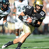 "Scotty McKnight  of CU takes a tipped ball in for a touchdown against Hawaii on Saturday.<br /> For more photos from the game, go to  <a href=""http://www.dailycamera.com"">http://www.dailycamera.com</a>.<br />  Cliff Grassmick / September 18, 2010"