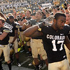 University of Colorado junior Toney Clemons, front, and other Buff players celebrate their victory on Saturday, Sept. 18, after the football game against the University of Hawaii at Folsom Field. CU defeated Hawaii 31-13.<br /> Jeremy Papasso/ The Camera