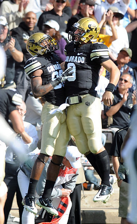 "Paul Richardson, left, and Tyler Hansen of CU, celebrate their hook up on a 2-point conversion against Hawaii.<br /> For more photos from the game, go to  <a href=""http://www.dailycamera.com"">http://www.dailycamera.com</a>.<br />  Cliff Grassmick / September 18, 2010"