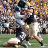 "Hawaii QB Bryant Moniz gets trapped in the endzone by Jon Major (31) and Tyler Ahles, both of CU. He fumbled and the play resulted in a safety for CU.<br /> For more photos from the game, go to  <a href=""http://www.dailycamera.com"">http://www.dailycamera.com</a>.<br />  Cliff Grassmick / September 18, 2010"