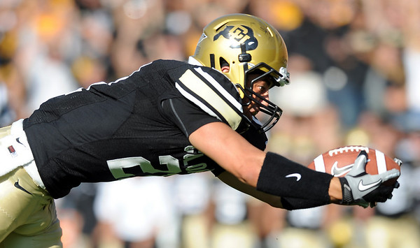 """Scotty McKnight  of CU takes a tipped ball in for a touchdown against Hawaii on Saturday.<br /> For more photos from the game, go to  <a href=""""http://www.dailycamera.com"""">http://www.dailycamera.com</a>.<br />  Cliff Grassmick / September 18, 2010"""