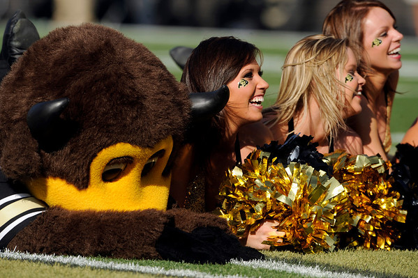 Chip lies on the ground with the University of Colorado cheerleaders in the third quarter of the football game on Saturday, Sept. 18, against the University of Hawaii at Folsom Field. CU defeated Hawaii 31-13.<br /> Jeremy Papasso/ The Camera