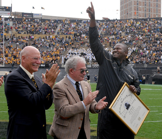 "CU Hall of Famers, Dick Anderson, left, Joe Romg, and now Alfred Williams, salute the crowd during a ceremony at halftime of the Hawaii game.<br /> For more photos from the game, go to  <a href=""http://www.dailycamera.com"">http://www.dailycamera.com</a>.<br />  Cliff Grassmick / September 18, 2010"