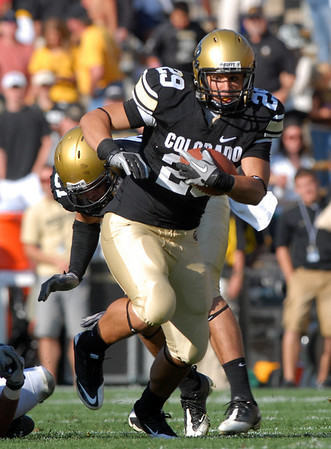 "Justin Torres of CU runs against Hawaii on Saturday.<br /> For more photos from the game, go to  <a href=""http://www.dailycamera.com"">http://www.dailycamera.com</a>.<br />  Cliff Grassmick / September 18, 2010"