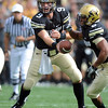 "Tyler Hansen of CU hands off to Rodney Stewart against Hawaii.<br /> For more photos from the game, go to  <a href=""http://www.dailycamera.com"">http://www.dailycamera.com</a>.<br />  Cliff Grassmick / September 18, 2010"