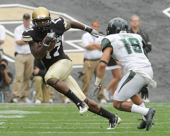 University of Colorado junior Toney Clemons runs the ball past Hawaii defender Richard Torres after making a catch on Saturday, Sept. 18, during the football game against the University of Hawaii at Folsom Field.<br /> Jeremy Papasso/ The Camera