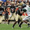 University of Colorado junior Brian Lockridge runs the ball after on Saturday, Sept. 18, during the football game against the University of Hawaii at Folsom Field.<br /> Jeremy Papasso/ The Camera