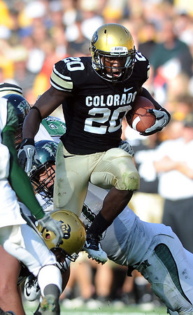 """Brian Lockridge gains over 100 yards against Hawaii on Saturday.<br /> For more photos from the game, go to  <a href=""""http://www.dailycamera.com"""">http://www.dailycamera.com</a>.<br />  Cliff Grassmick / September 18, 2010"""
