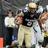 University of Colorado tailback Rodney Stewart shakes a tackle on Saturday, Sept. 18, while rushing the ball during the football game against the University of Hawaii at Folsom Field.<br /> Jeremy Papasso/ The Camera
