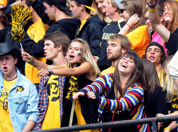 "Maura Kush, left and Paige Depaolis enjoy the game on Saturday.<br /> For more photos from the game, go to  <a href=""http://www.dailycamera.com"">http://www.dailycamera.com</a>.<br />  Cliff Grassmick / September 18, 2010"