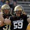 University of Colorado sophomore Jon Major gives senior B.J. Beatty a pat on the back after Beatty sacked Hawaii's quarterback Bryant Monlz in the fourth quarter on Saturday, Sept. 18, during the football game against the University of Hawaii at Folsom Field. CU defeated Hawaii 31-13.<br /> Jeremy Papasso/ The Camera