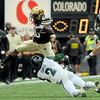 University of Colorado junior Brian Lockridge jumps over Hawaii defender Lametrius Davis while rushing the ball on Saturday, Sept. 18, during the football game against the University of Hawaii at Folsom Field.<br /> Jeremy Papasso/ The Camera