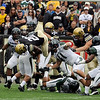 University of Colorado junior Brian Lockridge jumps over Hawaii's offensive line while rushing the ball on Saturday, Sept. 18, during the football game against the University of Hawaii at Folsom Field.<br /> Jeremy Papasso/ The Camera