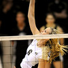 Colorado's Kerra Schroeder knocks the ball over the net against Kansas during their volleyball game at the University of Colorado in Boulder, Colorado November 4, 2009. CAMERA/Mark Leffingwell