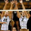 Colorado's Kaitlyn Burkett (right) and Schylur Edelman (left) try to block a shot during their volleyball game against Kansas at the University of Colorado in Boulder, Colorado November 4, 2009. CAMERA/Mark Leffingwell