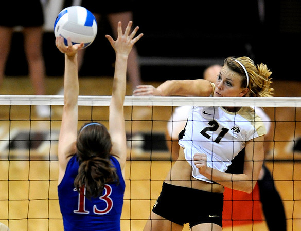 Colorado's Becah Fogle (right) knocks the ball past Kansas' Nicole Tate (left) during their volleyball game at the University of Colorado in Boulder, Colorado November 4, 2009. CAMERA/Mark Leffingwell