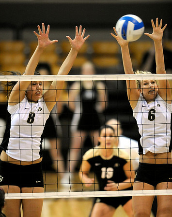 Colorado's Nikki Kinzer (left) and Kerra Schroeder (right) try to block a shot during their volleyball game against Kansas at the University of Colorado in Boulder, Colorado November 4, 2009. CAMERA/Mark Leffingwell