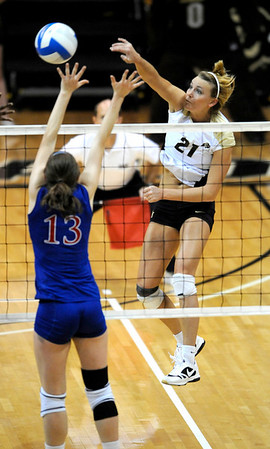 Colorado's Becah Fogle (rigth) hits the ball past Kansas' Nicole Tate (left) during their volleyball game at the University of Colorado in Boulder, Colorado November 4, 2009. CAMERA/Mark Leffingwell