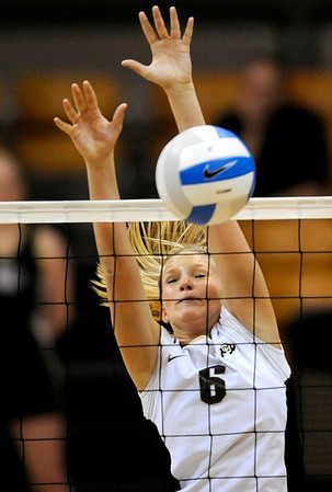 Colorado's Kerra Schroeder blocks a shot during their volleyball game against Kansas at the University of Colorado in Boulder, Colorado November 4, 2009. CAMERA/Mark Leffingwell