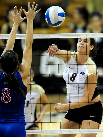 Colorado's Nikki Kinzer (right) spikes the ball past Kansas' Paige Mazour (left) during their volleyball game at the University of Colorado in Boulder, Colorado November 4, 2009. CAMERA/Mark Leffingwell