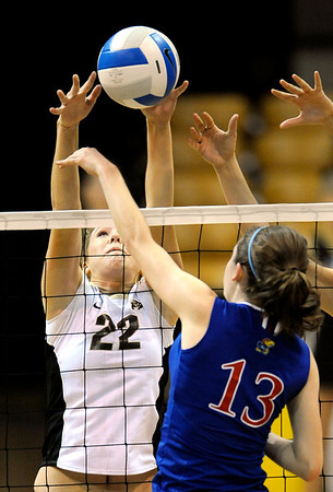 Colorado's Kaitlyn Burkett (left) blocks a shot from Kansas' Nicole Tate (right) during their volleyball game at the University of Colorado in Boulder, Colorado November 4, 2009. CAMERA/Mark Leffingwell