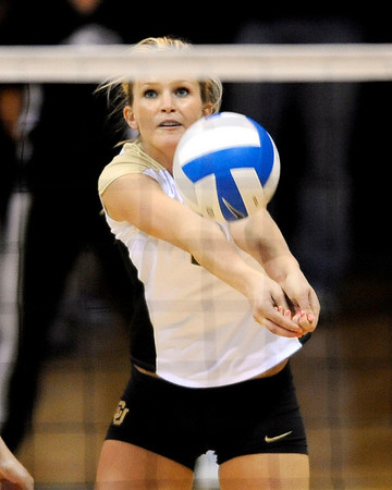Colorado's Kerra Schroeder bumps the ball to a teammate during their volleyball game against Kansas at the University of Colorado in Boulder, Colorado November 4, 2009. CAMERA/Mark Leffingwell