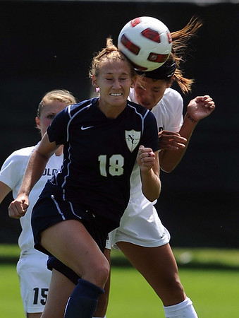 """Ariel Cook, left, of UNC, and Kym Lowry of CU, go for the header.<br /> For more photos of the game, go to  <a href=""""http://www.dailycamera.com"""">http://www.dailycamera.com</a>.<br /> Cliff Grassmick / August 29, 2010"""