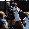 "Ariel Cook, left, of UNC, and Kate Russell of Colorado, connect on the header.<br /> For more photos of the game, go to  <a href=""http://www.dailycamera.com"">http://www.dailycamera.com</a>.<br /> Cliff Grassmick / August 29, 2010"