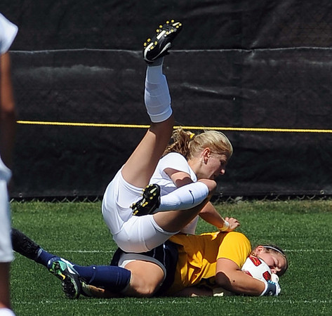 "Alex Dohm, top, of CU, collides with UNC keeper Kirstin Salminen at the Bears' goal.<br /> For more photos of the game, go to  <a href=""http://www.dailycamera.com"">http://www.dailycamera.com</a>.<br /> Cliff Grassmick / August 29, 2010"