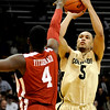 Colorado's Marcus Relphored (right) takes a 3-point shot over Oklahoma's Andrew Fitzgerald (left) during their basketball game at the University of Colorado in Boulder, Colorado February 17, 2010.  CAMERA/Mark Leffingwell