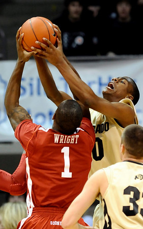 Colorado's Alec Burks (right) fights Oklahoma's Ryan Wright (right) for a rebound during their basketball game at the University of Colorado in Boulder, Colorado February 17, 2010.  CAMERA/Mark Leffingwell