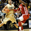 Colorado's Marcus Relphorde (left) is fouled by Oklahoma's Andrew Fitzgerald (right) during their basketball game at the University of Colorado in Boulder, Colorado February 17, 2010.  CAMERA/Mark Leffingwell