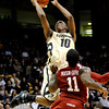 Colorado's Alec Burks (left) takes a shot over the top of Oklahoma's Tommy Mason-Griffin (right) during their basketball game at the University of Colorado in Boulder, Colorado February 17, 2010.  CAMERA/Mark Leffingwell