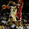 Colorado's Dwight Thorne II (left) is fouled by Oklahoma's Tony Crocker (right) during their basketball game at the University of Colorado in Boulder, Colorado February 17, 2010.  CAMERA/Mark Leffingwell