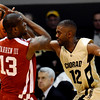 Colorado's Dwight Thorne II (left) knocks the ball from Oklahoma's Willie Warren (rigth) during their basketball game at the University of Colorado in Boulder, Colorado February 17, 2010.  CAMERA/Mark Leffingwell