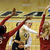 "Nikki Lindow of CU tries to hit past Cortney Warren and Sallie McLaurin of OU.<br /> For more photos from the game, go to  <a href=""http://www.dailycamera.com"">http://www.dailycamera.com</a>.<br />  Cliff Grassmick / September 15, 2010"