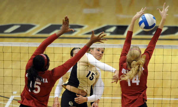 """Nikki Lindow of CU tries to hit past Cortney Warren and Sallie McLaurin of OU.<br /> For more photos from the game, go to  <a href=""""http://www.dailycamera.com"""">http://www.dailycamera.com</a>.<br />  Cliff Grassmick / September 15, 2010"""