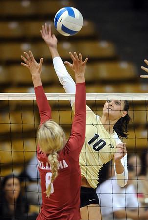 """Anicia Santos of CU hits around Morgan Reynolds of OU.<br /> For more photos from the game, go to  <a href=""""http://www.dailycamera.com"""">http://www.dailycamera.com</a>.<br />  Cliff Grassmick / September 15, 2010"""