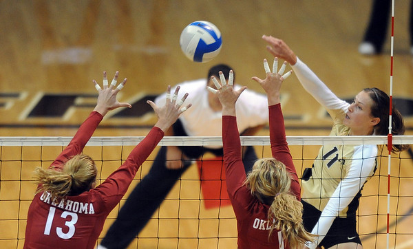 "Rosie Steinhaus of CU hits past Sarah Freudenrich, left, and Brianne Barker of Oklahoma.<br /> For more photos from the game, go to  <a href=""http://www.dailycamera.com"">http://www.dailycamera.com</a>.<br />  Cliff Grassmick / September 15, 2010"