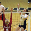 "Richi Bigelow of Colorado hits over Morgan Reynolds of OU.<br /> For more photos from the game, go to  <a href=""http://www.dailycamera.com"">http://www.dailycamera.com</a>.<br />  Cliff Grassmick / September 15, 2010"