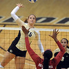 "Nikki Lindow of Colorado hits past Courtney Warren of Oklahoma.<br /> For more photos from the game, go to  <a href=""http://www.dailycamera.com"">http://www.dailycamera.com</a>.<br />  Cliff Grassmick / September 15, 2010"