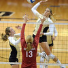 "Nikki Lindow of Colorado hits over Sarah Freudenrich of Oklahoma.<br /> For more photos from the game, go to  <a href=""http://www.dailycamera.com"">http://www.dailycamera.com</a>.<br />  Cliff Grassmick / September 15, 2010"