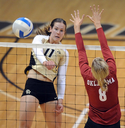 """Rosie Steinhaus of CU gets the ball past Morgan Reynolds of OU.<br /> For more photos from the game, go to  <a href=""""http://www.dailycamera.com"""">http://www.dailycamera.com</a>.<br />  Cliff Grassmick / September 15, 2010"""