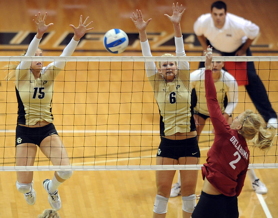 """.Suzy Boulavsky of Oklahoma tries to get the ball past Nikki Lindow and Kerra Schroeder of CU<br /> For more photos from the game, go to  <a href=""""http://www.dailycamera.com"""">http://www.dailycamera.com</a>.<br />  Cliff Grassmick / September 15, 2010"""